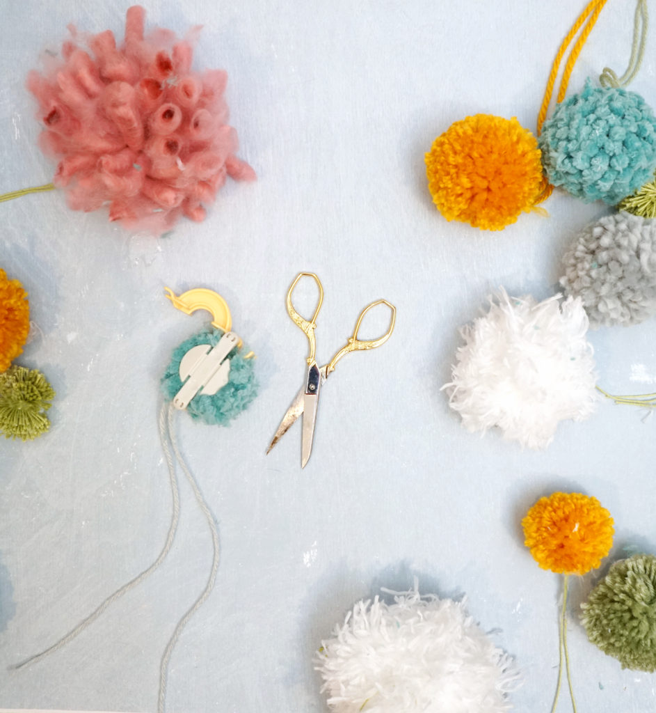 Making pom poms for a DIY spring wreath