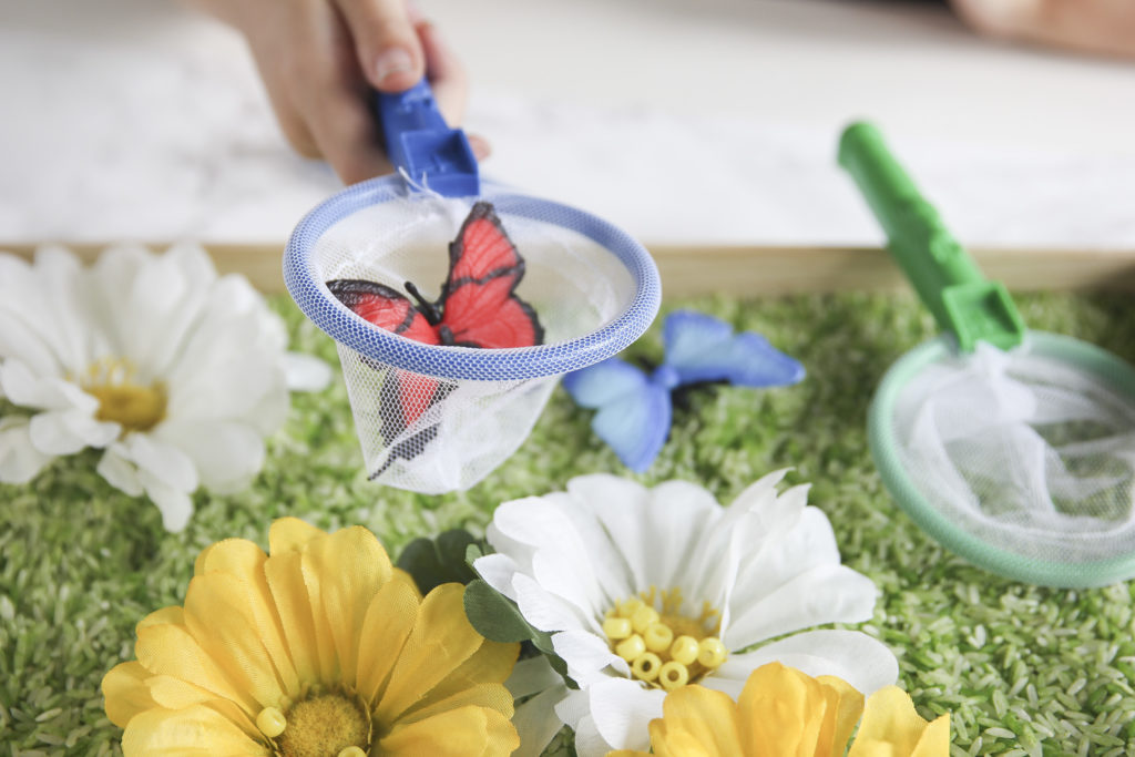 Make a DIY sensory bin filled with flowers and butterflies for spring