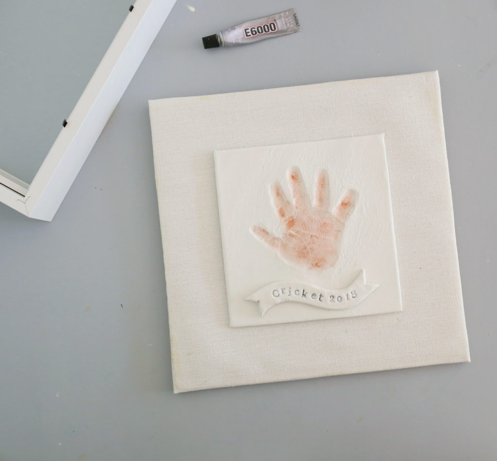Apply metallic wax to your child's DIY handprint