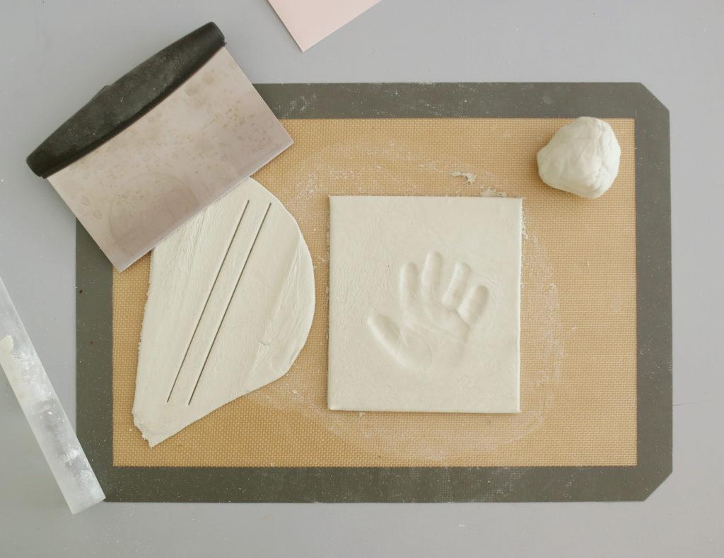 Step 4 of DIY clay handprint in a shadowbox