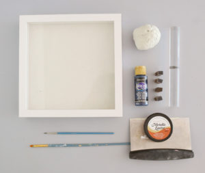 Supplies to make a DIY clay handprint in a frame