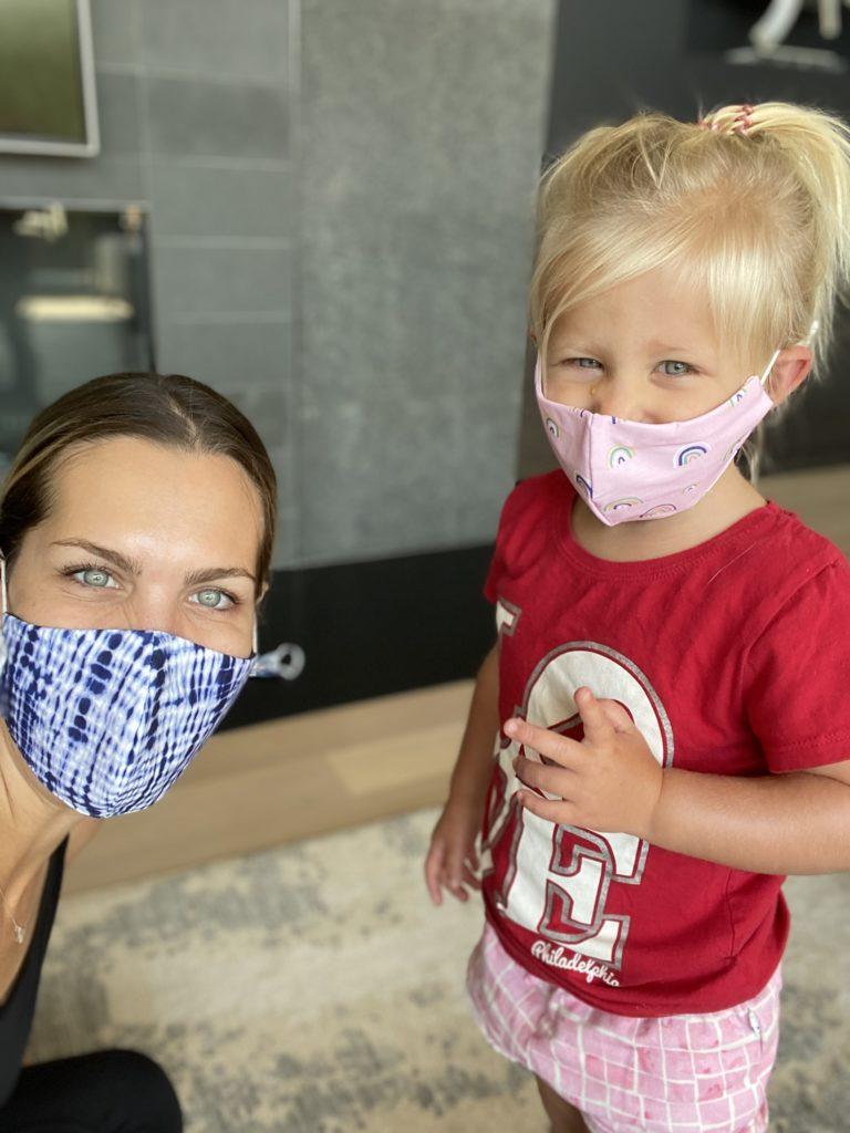 Erica Scherzer and daughter wearing face masks